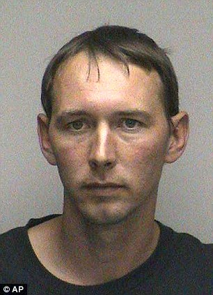 Shawn Paholke is seen in an undated photo provided by the Oconto County Jail. Paholke, 33, and Jennifer Fendryk, 31, are charged with 23 felonies relating to the treatment of Paholke's daughters, ages 5 and 7