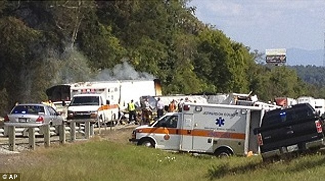 The crash was caused when a tire on the tour bus blew out, causing it to veer across the median and into oncoming traffic
