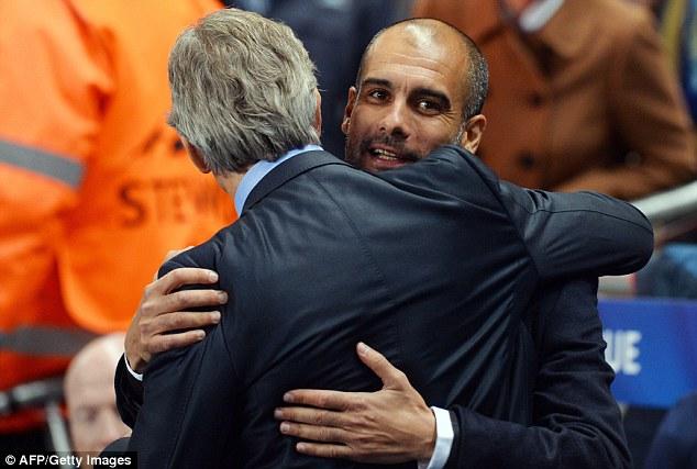 Battle: Guardiola hugs Manuel Pellegrini but the clash between their teams wasn't as friendly