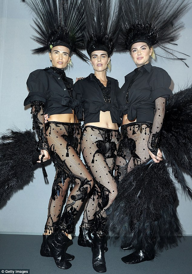 Working it: The trio looked like Gothic showgirls in their unusual ensembles