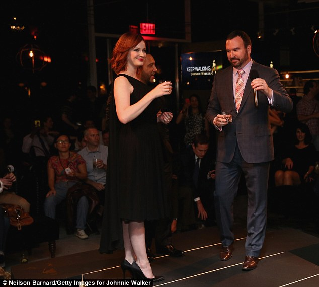Bottoms up: The Mad Men actress toasted the launch of the scotch whiskey company's platinum brand at the House of Walker