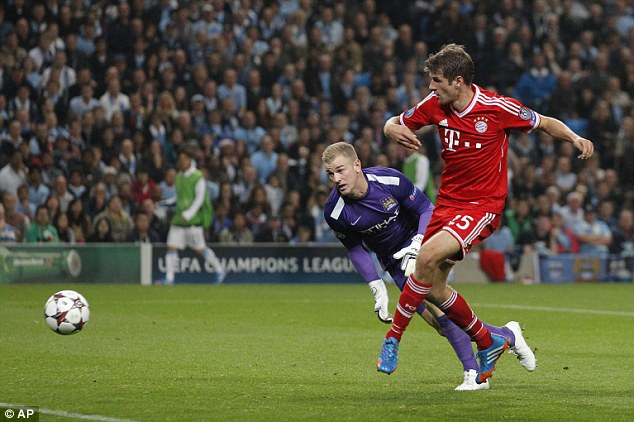 Rough night: Hart was hardly culpable for Thomas Muller's (right) goal that put Bayern two up