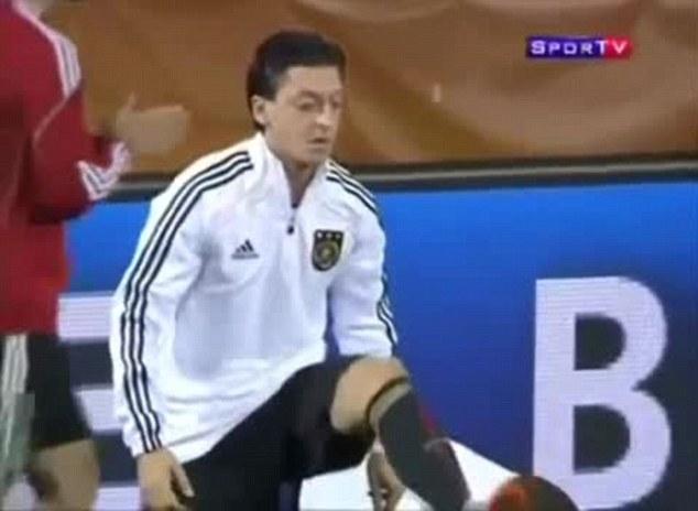 Kick: Ozil boots his gum