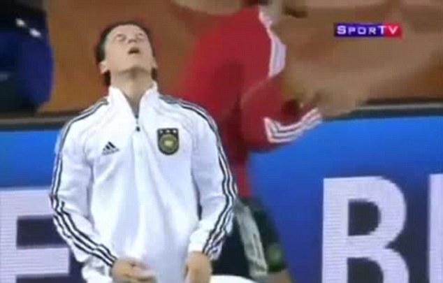 Catch: Ozil prepares to meet his gum