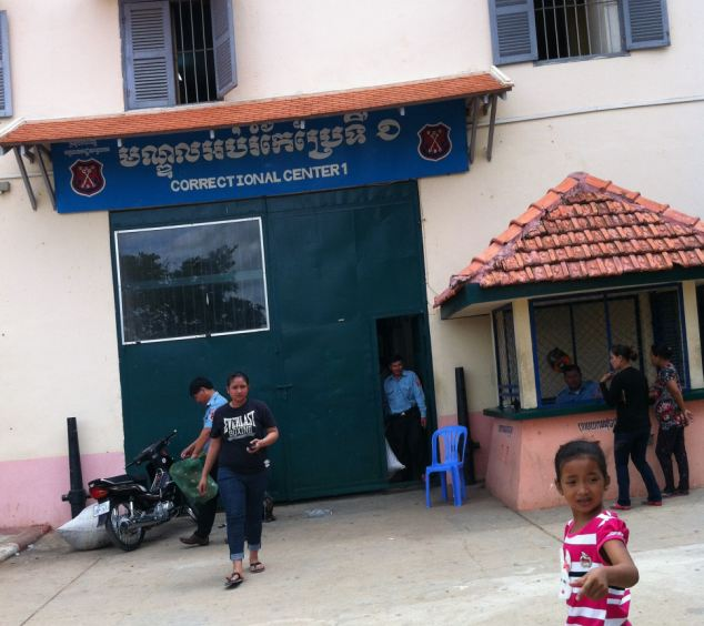 Visitors at the entrance to Cambodia's notorious Prey Sar Prison where Fletcher will serve a 10-year prison sentence