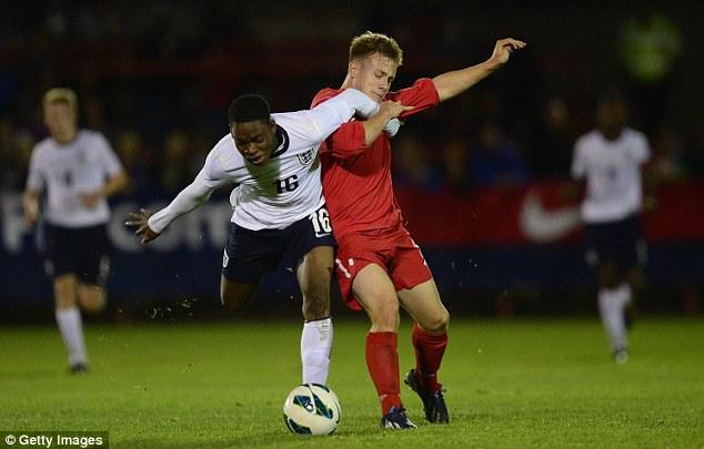 Battle: England's Jonathan Leko battles for the ball with Sam Williams