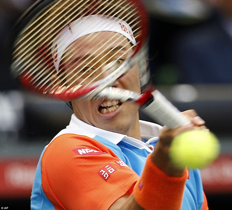 Making a racket: Kei Nishikori returns a shot against Feliciano Lopez during their second round match at the Japan Open in Tokyo