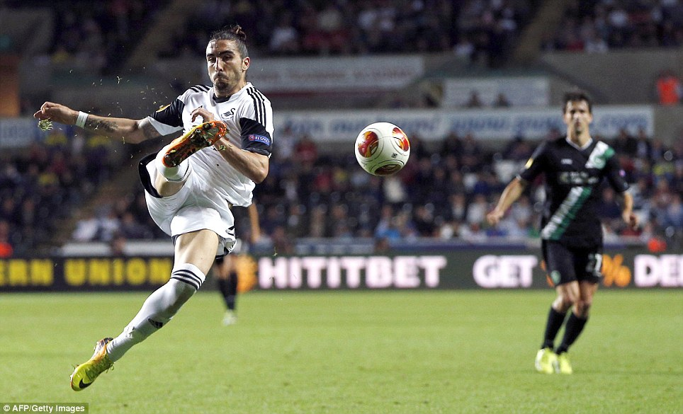 Flying start: Chico Flores acrobatically clears the ball in Swansea's 1-0 win over St Gallen