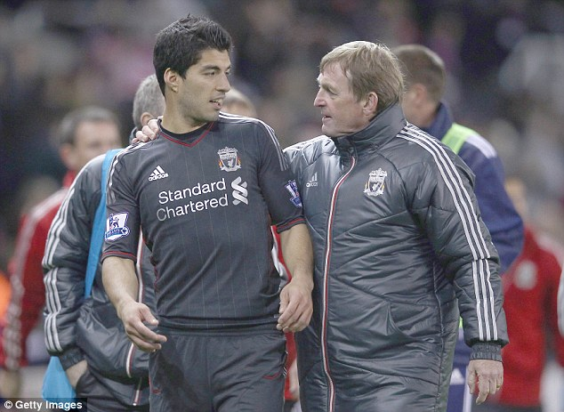 Past master: Dalglish with Luis Suarez (left) during his second spell in charge at Anfield