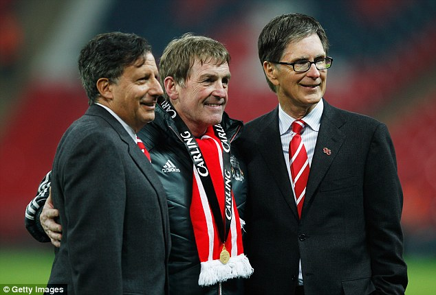 Reunited: Dalglish (centre) with Liverpool chairman Tom Werner (left) and owner John W Henry after winning the Carling Cup in 2012