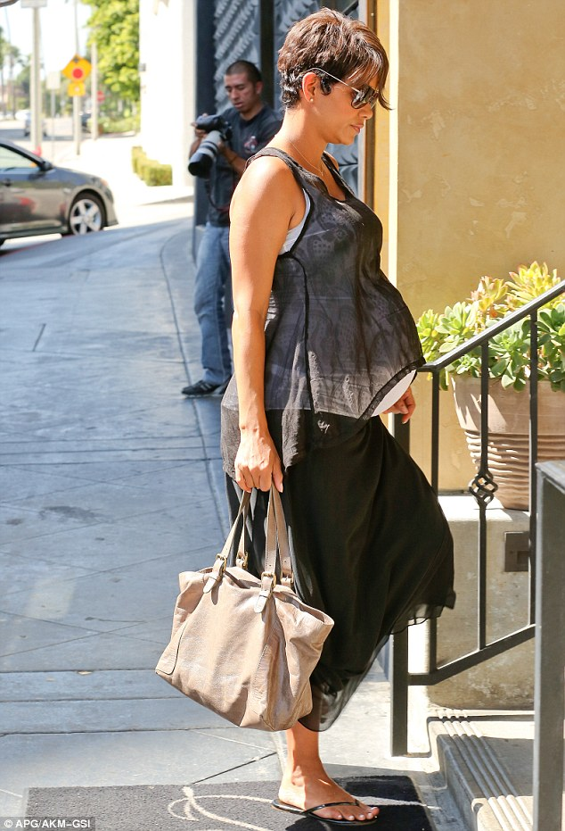 Easy on the feet... Halle opted to wear flip flops with her summery outfit
