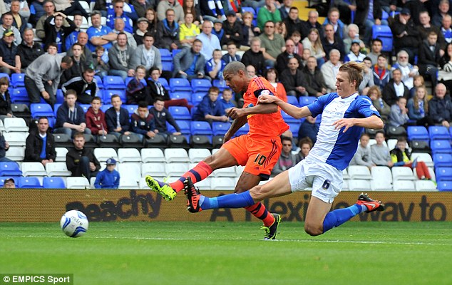 Cool finish: Bolton's Jermaine Beckford beat Randolph at the near post after a break against the run of play