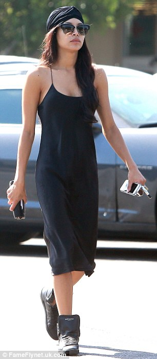 Got the look: T 26-year-old  looked the prefect blend of Hollywood It Girl and Hip Hop royalty wearing a silk black dress with a pair of black high top sneakers and a striking turban