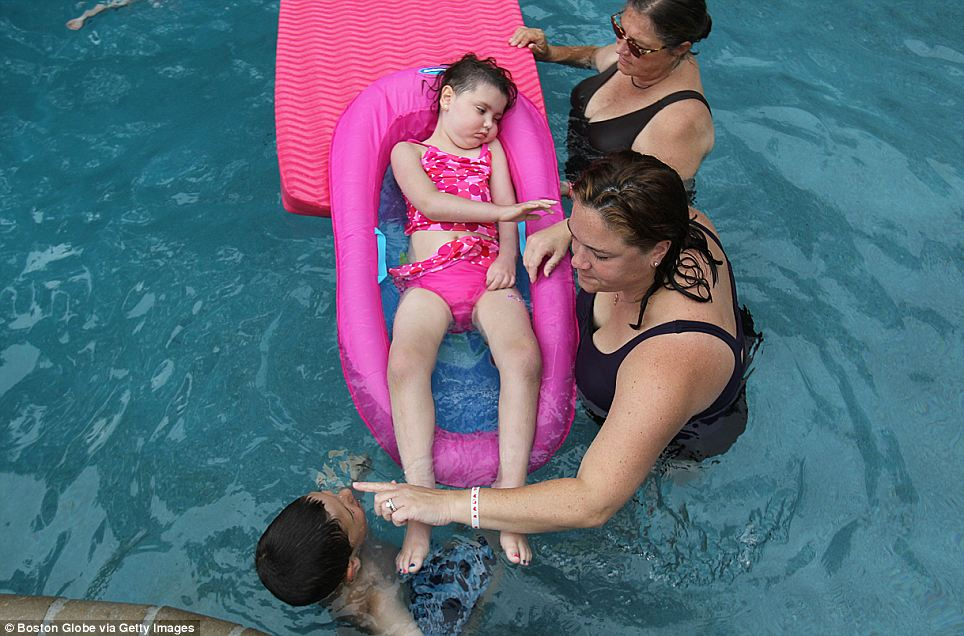 A last swim: Five days before her death, Calle and her family have a cook out for friends and family and swim in their newly built pool. Calle can hardly move at this point
