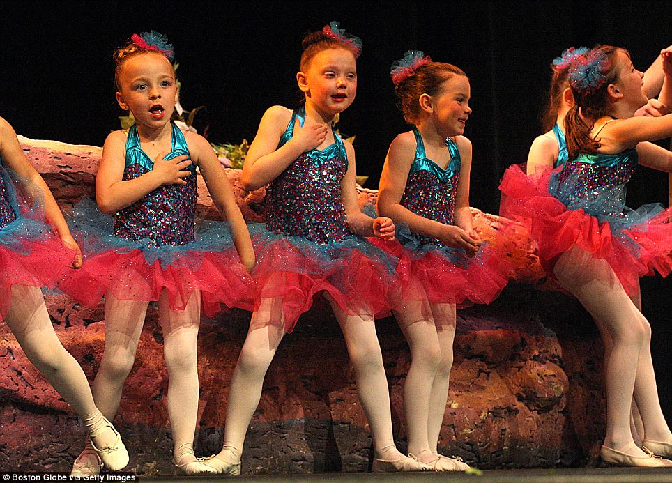 Last dance: Caroline Cronk, 5, second from left, loved to dance. This is her at the spring dance recital which was moved up as her tumour began to grow again