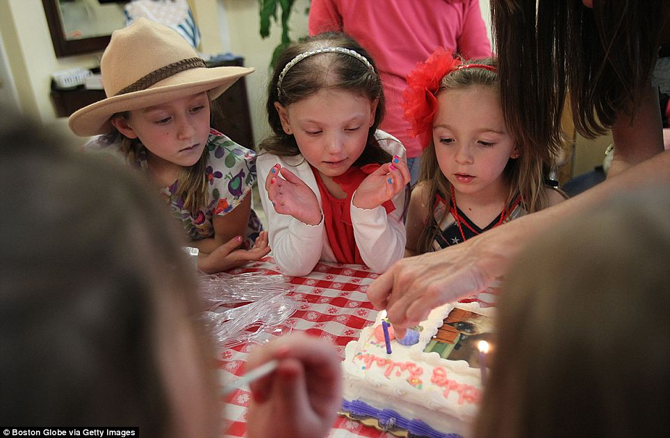 Friends and fun: Caroline, centre, was always trying to have fun. Here she is at her friend's birthday party
