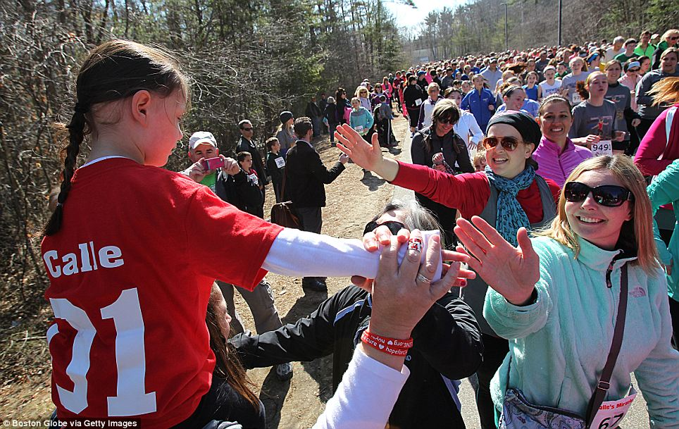 Supporters: About 2,000 people came out to run in the Calle's Miracle Run event, which her parents said was a day they would never forget