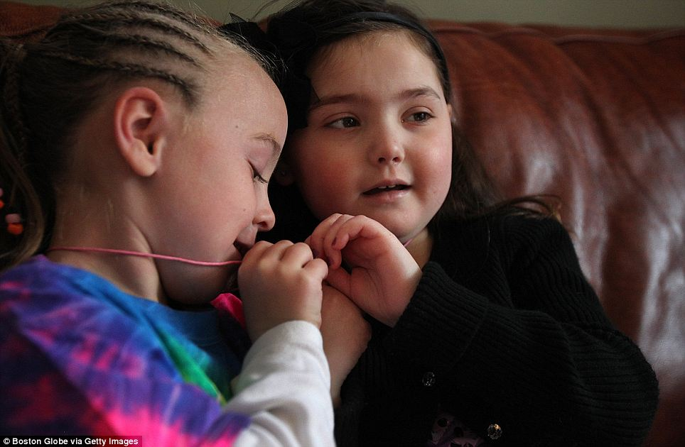 Getting better: Caroline 'Calle' Cronk, right, and her best friend, Lilah Magee, get Best Friend necklaces as Caroline starts to feel better
