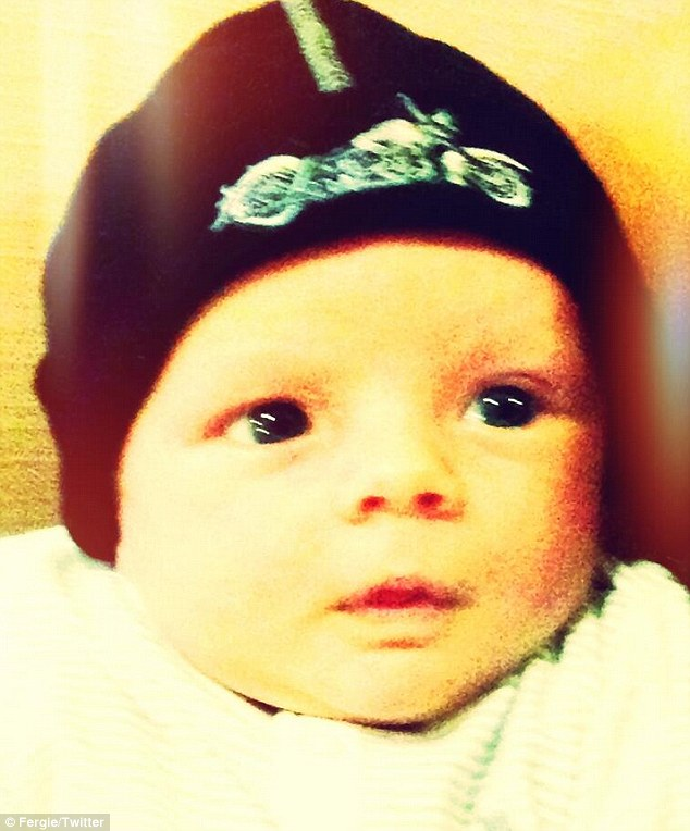 Little rebel: Five-week-old Axl donned a Sons Of Anarchy beanie in this cute photo Fergie posted with the caption, 'Aaahh #BreakingBad is done!! Still learning valuable life lessons on #SonsOfAnarchy. #mommystvshowsrock'