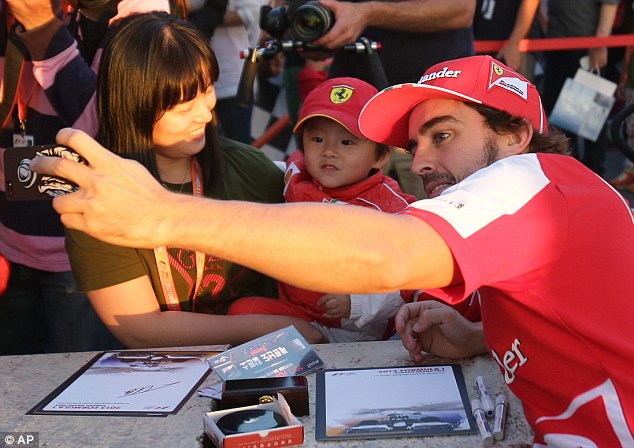 That's better: Alonso had been in high spirits earlier in the day as he signed autographs and posed for pictures with young fans