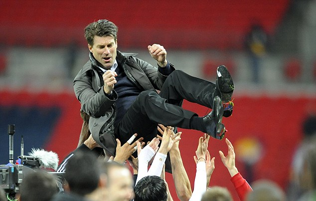 Popular: Laudrup led Swansea to Capital One Cup glory and they lead group A of the Europa League