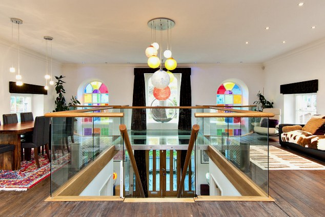 Open plan: The stairs, designed by Mario, which leads up to the lounge and kitchen