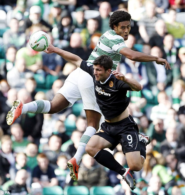 Aerial tussle: Celtic's Virgil van Dijk (left) and Motherwell's John Sutton go up for the ball