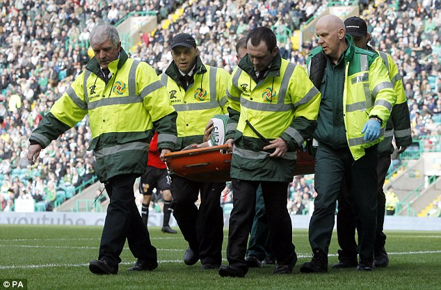 Injury blow: Adam Matthews was stretchered off the pitch with a shoulder injury