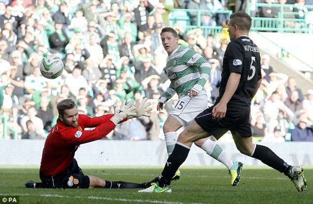 That'll do it: Kris Commons scores Celtic's second goal four minutes after half-time at Parkhead