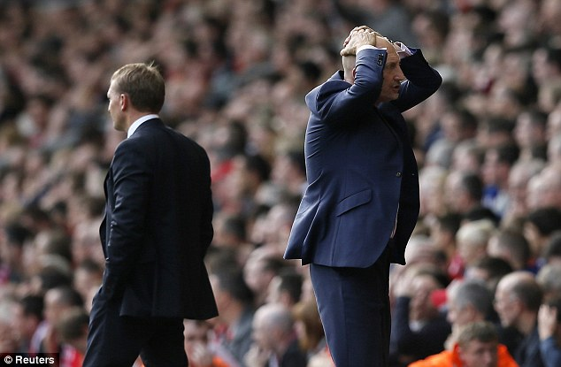 Tough day at the office: Crystal Palace manager Ian Holloway, right, saw his side lose 3-1 at Liverpool