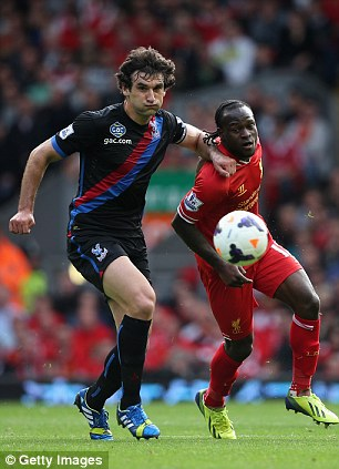 Tussle: Palace midfielder Mile Jedinak holds off a challenge from Liverpool's Victor Moses
