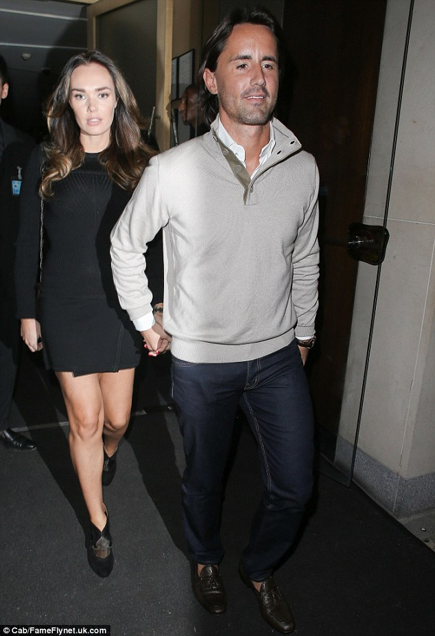 Bumping along nicely: The couple looked more loved-up than ever as they emerged from London's Nobu Mayfair restaurant holding hands after grabbing a bite to eat