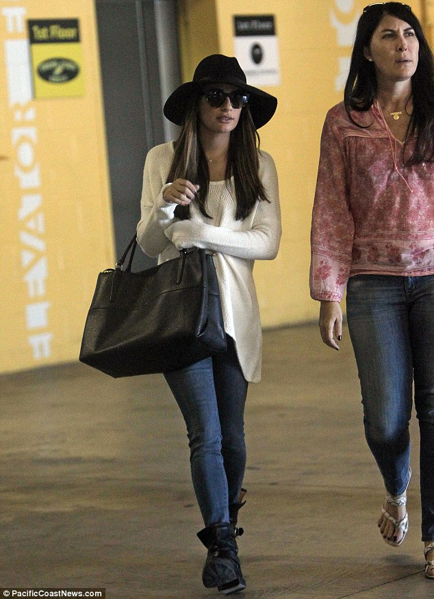 Still hiding a bit... But the actress did conceal herself with a pair of oversized, cat-eye sunglasses and a wide-brimmed hat
