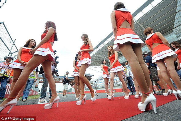 Red carpet: The drivers were escorted onto the circuit by the track girls left in red