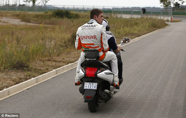 Scooter: A disgruntled Di Resta was then carried away by an official
