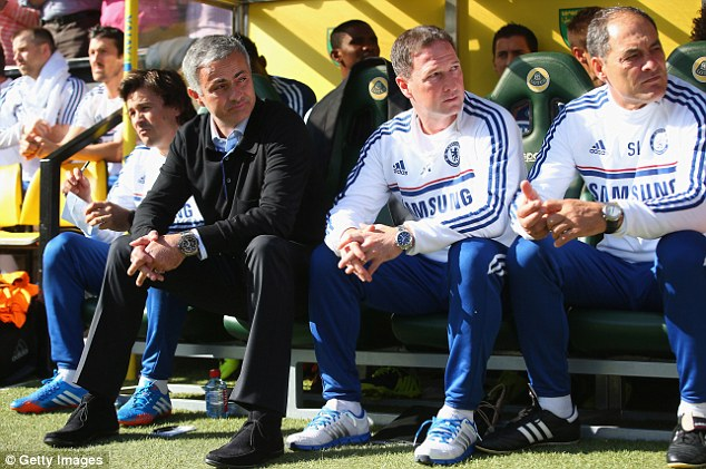 Watching on: Chelsea manager Jose Mourinho (left) and his coaching staff in the away dug-out at Carrow Road