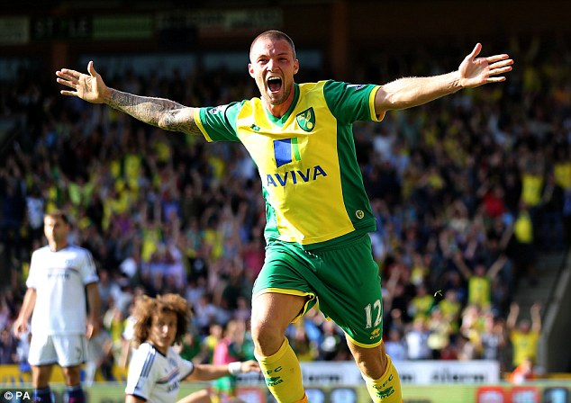 Equaliser: Norwich's Anthony Pilkington celebrates his goal to make it 1-1 as Chelsea's David Luiz looks on