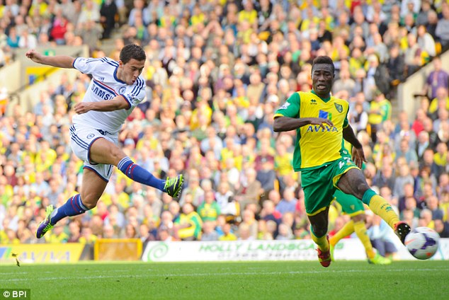 Hitting the front: Eden Hazard restores Chelsea's lead late on with a shot that squeezed under the body of John Ruddy