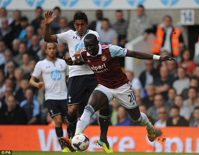 Muscle on muscle: Paulinho tussles with Mohamed Diame in the midfield