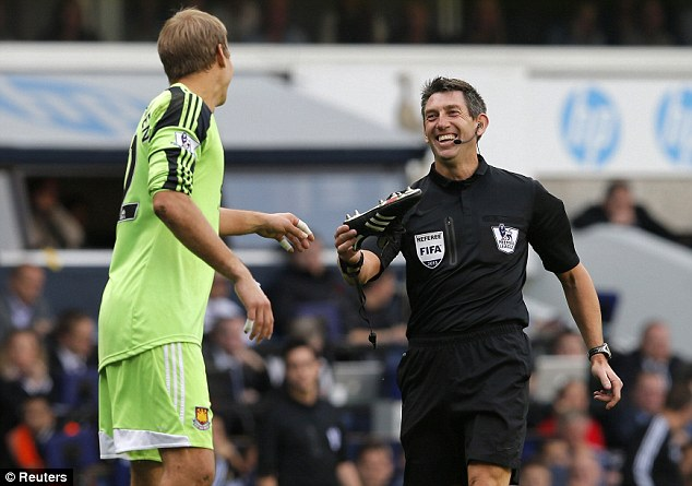 All smiles: Referee Lee Probert gives back Jussi Jaaskelainen's boot