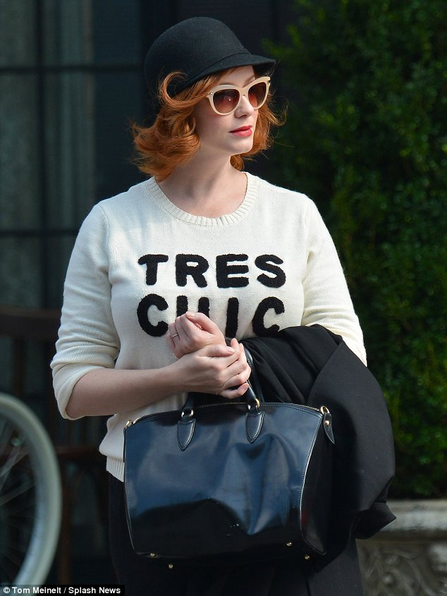 Tres chic: From the waist up, Mad Men actress Christina Hendricks lived up to the slogan on her sweater during an outing in New York on Saturday