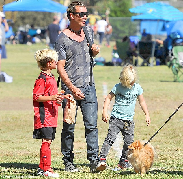 Guys' day out: Gavin Rossdale and his youngest son Zuma showed support for Kingston as he competed in his soccer tournament on Saturday