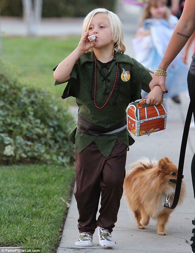 He never wants to grow up! Little Zuma donned a cute Peter Pan costume as he headed to his pal's party, clutching a treasure chest box and blowing on a seashell-shaped whistle, while he also went shoeless