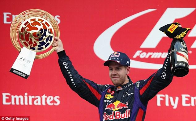 Champion again in all but name: Sebastian Vettel celebrates his fourth successive victory