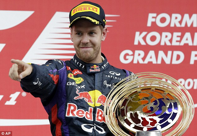 The world's best: Red Bull's Sebastian Vettel celebrates on the podium after winning the Korean Formula One Grand Prix