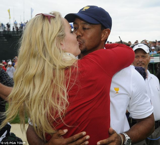 Clincher: Tiger Woods is congratulated by girlfriend Lindsey Vonn