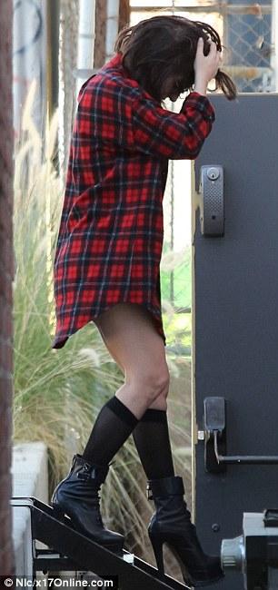 Teetering: The five-time Grammy winner flaunted her toned pins in sheer black knee socks and her favourite, sky-high bootie heels