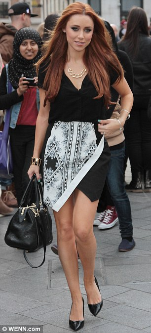 Monochrome chic: Una showed off her slim figure in a printed monochrome dress and sky-high heels