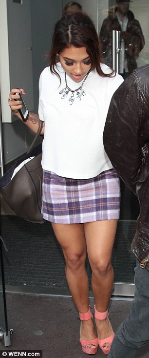 Leggy lady: Vanessa wore an on-trend tartan miniskirt, white T-shirt and pink wedge heels