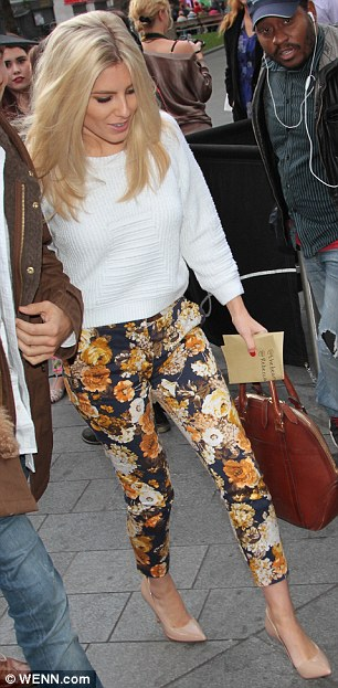 Standing out: Mollie teamed the trousers, which flattered her slim figure, with a white knitted jumper